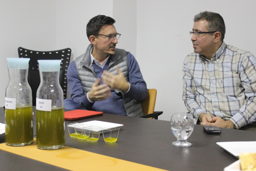 Chiheb Slama, right, presents the company's latest olive oil production to Italian clients